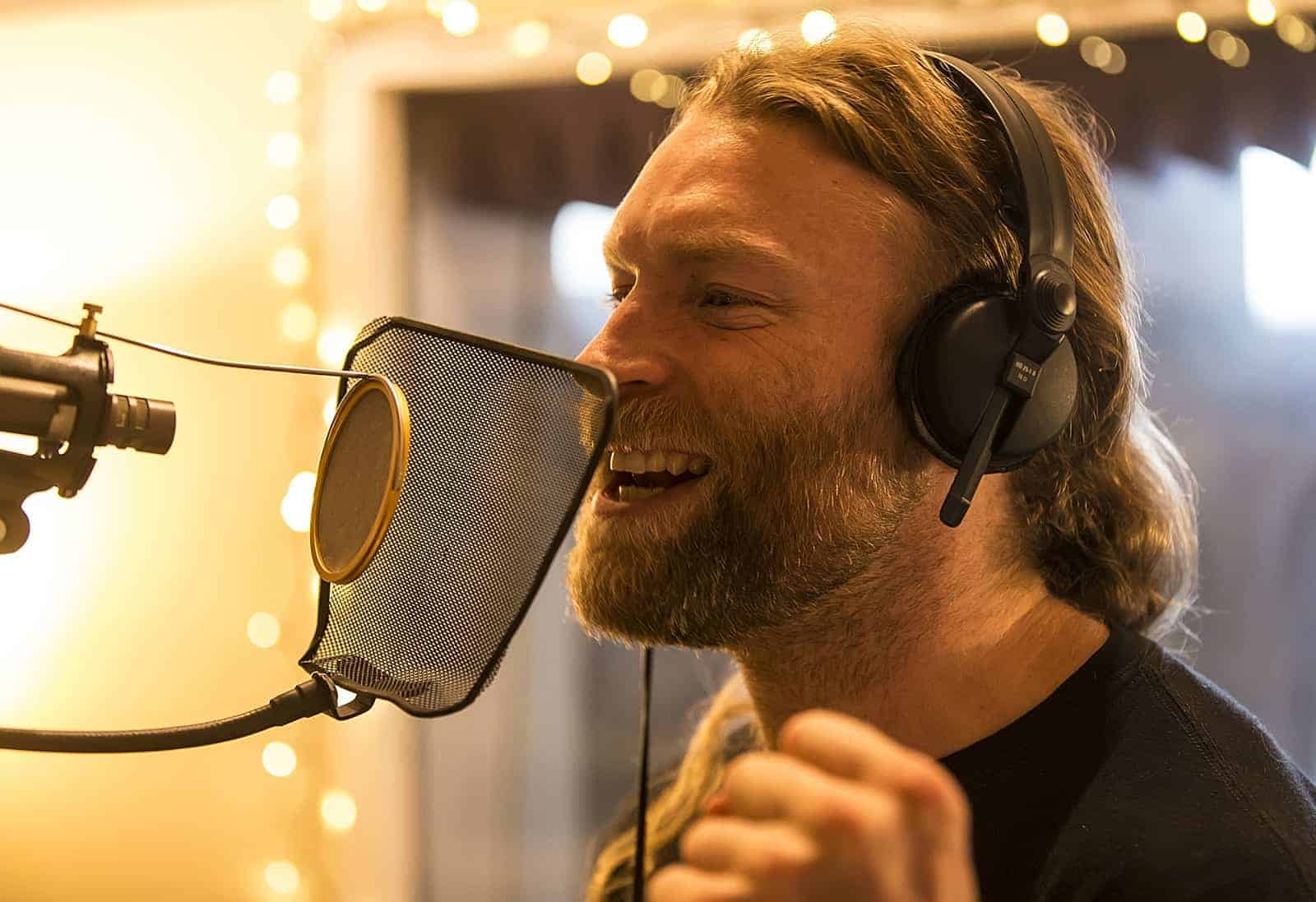Guy recording the vocals